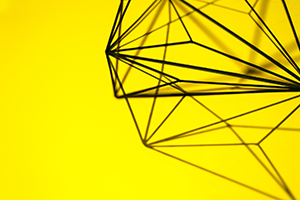 Wire sculpture on yellow background